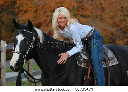 Cowgirl on a Horse - stock photo