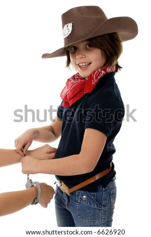 Cowgirl sheriff handcuffing a culprit. - stock photo