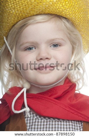 cowgirl with bright yellow hat is looking directly at camera