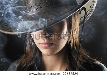 cowgirl with Smoke - stock photo