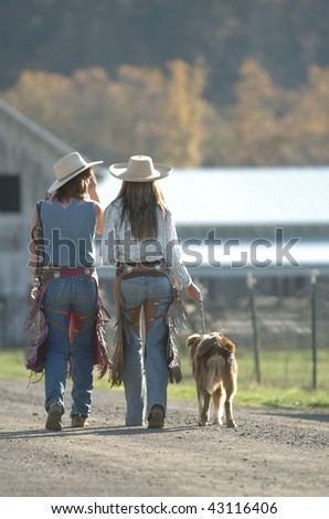 Cowgirls walking home - stock photo