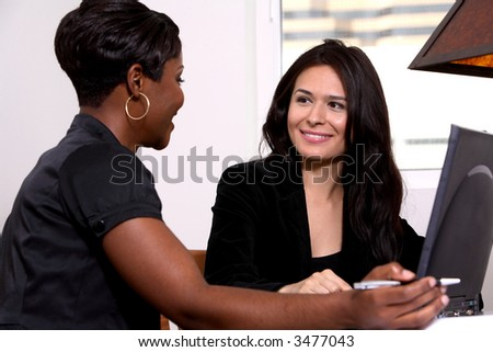 coworker teaching other at computer - stock photo