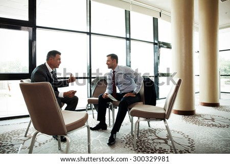 Coworkers discussing project in conference room