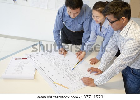 Coworkers discussing project in the office - stock photo