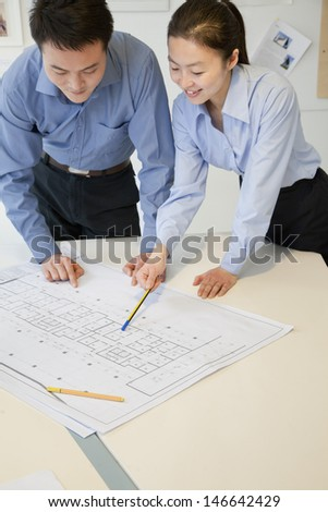 Coworkers discussing project in the office