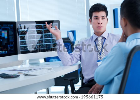 Coworkers discussing the decrease of the market - stock photo