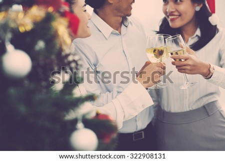 Coworkers having New Year party in the office - stock photo