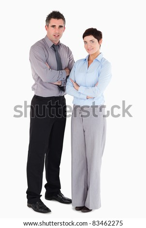 Coworkers standing up against a white background - stock photo