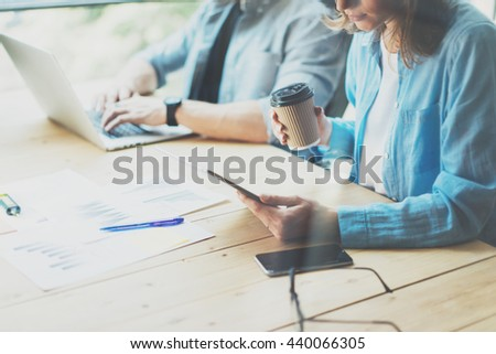 Coworkers team researching process in modern loft.Project managers working.Holding tablet female hand.Young business crew working with new startup office.Risk management process.Blurred,film effect - stock photo