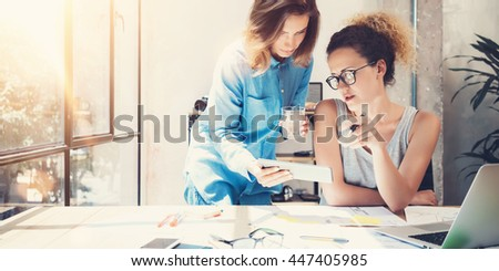 Coworkers Team Work Process Modern Interior Loft Office.Creative Producers Making Great Decisions New Idea.Young Business Crew Working Startup.Documents Wood Table.Analyze Reports.Blurred Film Effect - stock photo