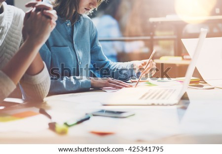 Coworkers work modern studio.Sales manager team working new project.Young business crew with startup.Laptop computer on wood table,creative idea presentation.Blurred,film effect.Horizontal - stock photo