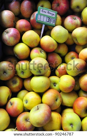 Cox's Orange Pippin apples for sale on a market stall, with the price tag - stock photo