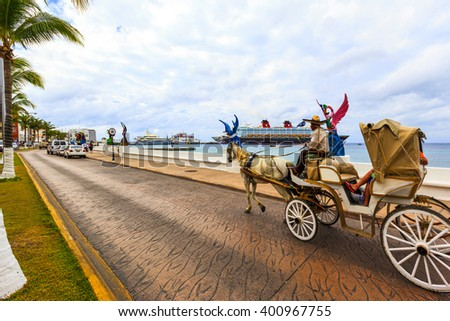 COZUMEL MEXICO JAN 26 2016:Colorful souvenir, coffee shops and transport in town. Tourists can buy various souvenirs and memory about this tropical Island. The economy of Cozumel is based on tourism. - stock photo