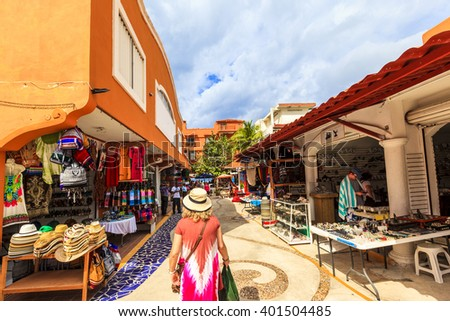 COZUMEL MEXICO JAN 26 2016:Colorful souvenir, coffee shops located in town. Tourists can buy various souvenirs as a memory about beautiful Tropical Island. The economy of Cozumel is based on tourism. - stock photo