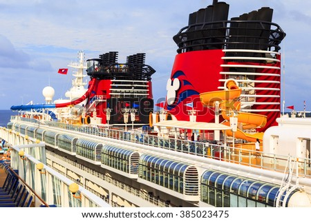 COZUMEL, MEXICO - JAN 26 2016: NCL Dawn & Disney Magic at Cozumel port.   Over 6500 passengers  visited that beautiful tropical island. The economy of Cozumel is based on tourism. - stock photo