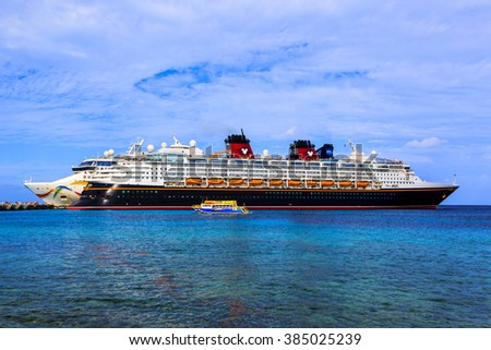 COZUMEL, MEXICO - JAN 26 2016: NCL Dawn & Disney Magic at Cozumel port.   Over 6500 passengers  visited that beautiful tropical island. The economy of Cozumel is based on tourism.