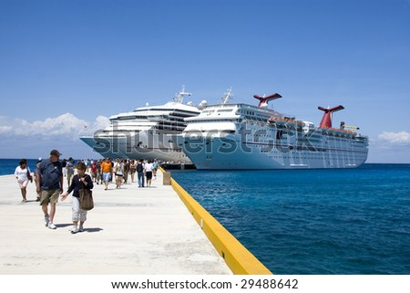 COZUMEL, MEXICO - MARCH 23 : Carnival Cruise Line ships dock at the harbor March 23, 2009 in Cozumel, Mexico.