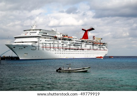 COZUMEL, MEXICO - MARCH 20: The Carnival Inspiration, shown at dock sails from Tampa, FL after being completely refurbished in 2007 in Cozumel, Mexico on March 20, 2010. - stock photo