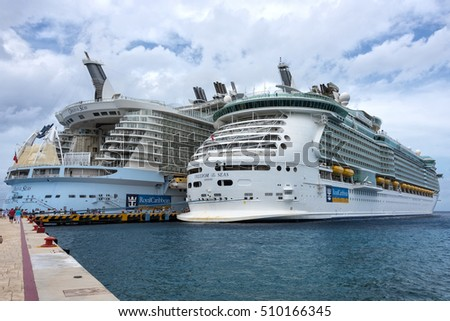 Cozumel Mexico - November 2nd 2016: Two cruise ships, The Freedom of the Seas and The Oasis of the Seas dock together in Cozumel Mexico November 2nd 2016.