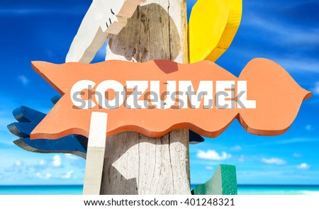 Cozumel signpost with beach background - stock photo