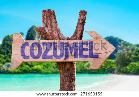 Cozumel wooden sign with beach background - stock photo