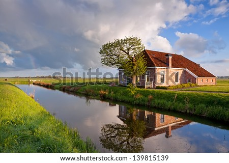 cozy and charming farmhouse by river, Groningen, Netherlands - stock photo