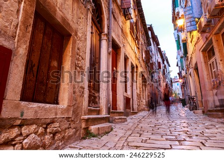 Cozy and narrow streets in Rovinj's medieval old town, Croatia - stock photo