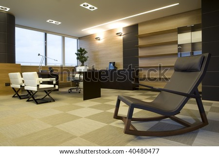 cozy armchair in modern office - stock photo