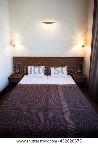 Cozy Bedroom.Bedroom Two Beds.Luxury Bedroom.Sleeping Hotel Suite.Hotel Suite.Hotel Bedroom.Double Bed.Wooden Double Bed.Classic Wooden Bed.Bedroom Lighting.Hotel Bedroom. - stock photo