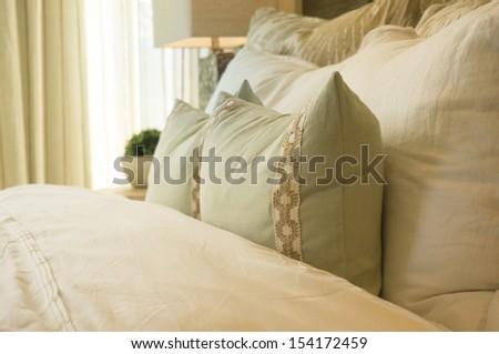 Cozy comfortable welcoming bedding in bedroom - stock photo