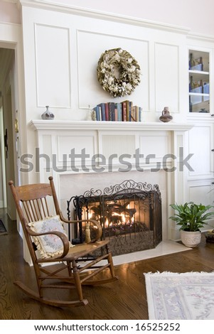 cozy fireplace and rocking chair - stock photo