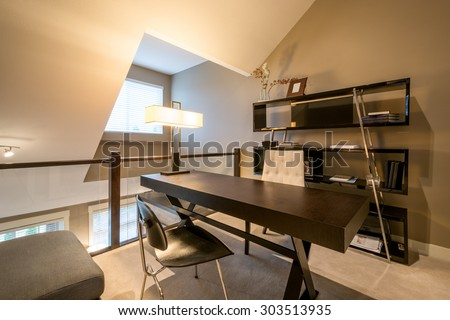 Cozy home office with a desk, bookcase, and chaise lounge. Interior design. - stock photo