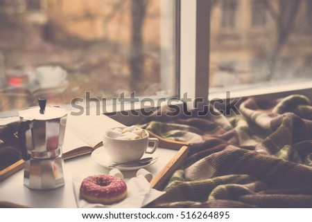 Cozy home winter with coffee and blanket