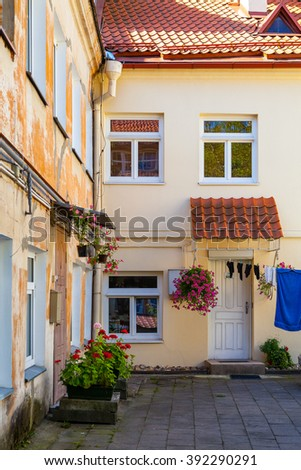 Cozy house and courtyard in old town of Vilnius, Lithuania. Tourist destination - stock photo