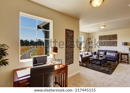 Cozy house interior. Living room with office area