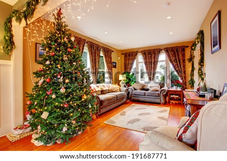 Cozy house interior on Christmas eve. View of living room with Christmas tree - stock photo