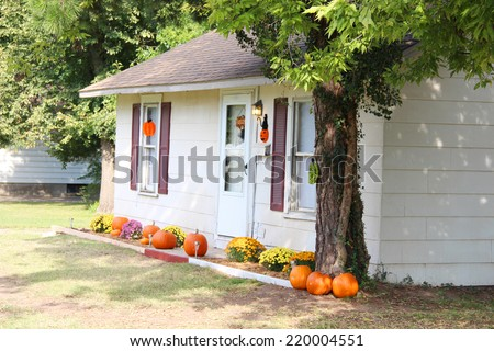 Cozy house with a nice yard - stock photo