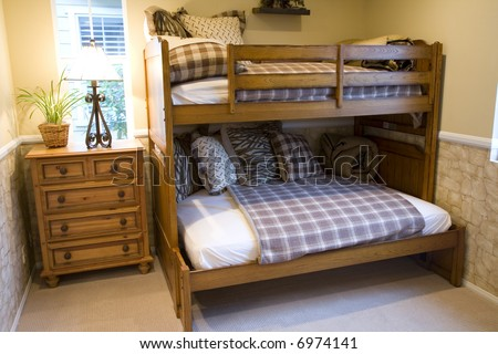 Cozy kids bedroom with a bunk bed. - stock photo