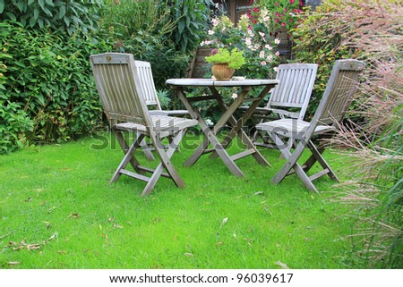 Cozy little backyard with outdoor furniture. - stock photo