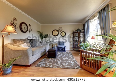Cozy Living room design with nice decor, large beige sofa and small TV. - stock photo