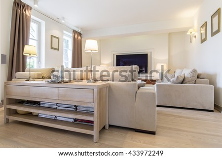 Cozy living room in white and beige with comfortable sofa set