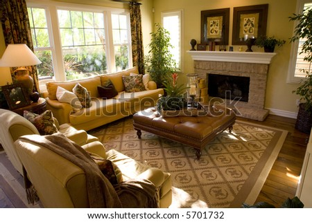 Cozy living room with a fireplace. - stock photo
