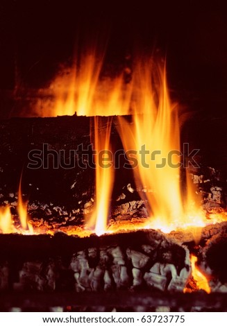 cozy log fire in fireplace - stock photo