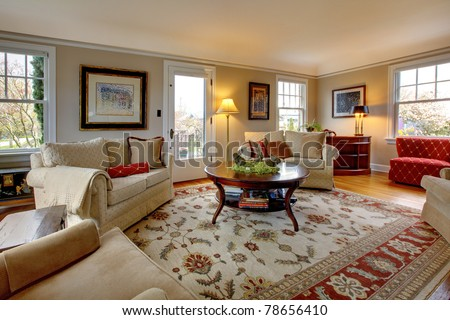 Cozy luxury living room with beige and red - stock photo
