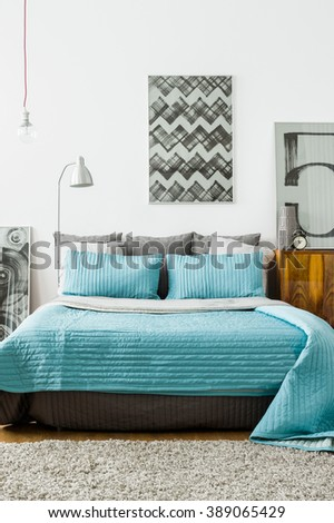 Cozy modern designed bedroom with double bed