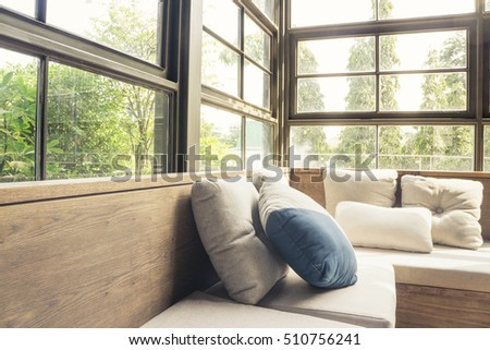 Cozy modern living room sofa couch corner with big glass window interior background
