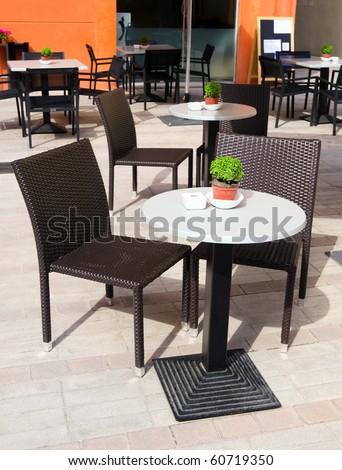 Cozy modern street cafe in Spain - stock photo