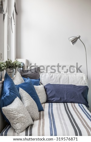 Cozy nook for sleeping in boy's room - stock photo