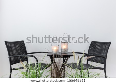 Cozy place for relaxation, decorated with lanterns and plants. - stock photo
