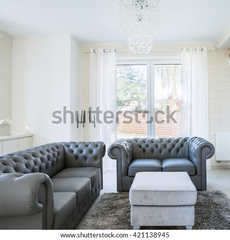 Cozy place to relax in big modern house - stock photo
